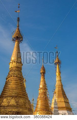 The Stupas Of The Shwedagon Pagoda In The Evening Sunlight, In Yangon, Myanmar