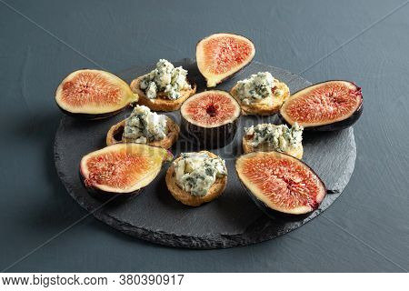 Toast With Roquefort Cheese And Fresh Figs, On A Rustic Background
