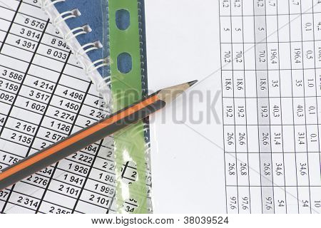 Business Documents And A Pencil