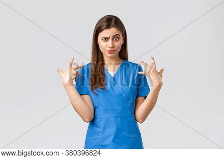 Healthcare Workers, Prevent Virus, Insurance And Medicine Concept. Funny Displeased Female Nurse In