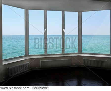 Cozy Room Overlooking The Sea. Landscape With Ocean. Modern Plastic Window With View Of Horizon With