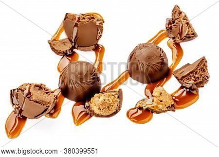 Chocolate Candies With Melting Caramel Isolated On White Background. Caramel Bonbons Top View, Macro