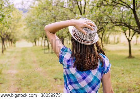 Beautiful Woman In Nature. Happy People Lifestyle. Woman Walking In Orchard. Nature Lifestyle. Happi