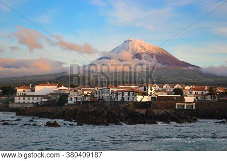 The Highest Mountain Of Portugal, The Azores Volcano Montanha Do Pico On The Island Of Pico At Sunse