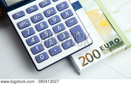 Business Still-life From A Calculator And A Bundle Of Banknotes 200 Euros Top View