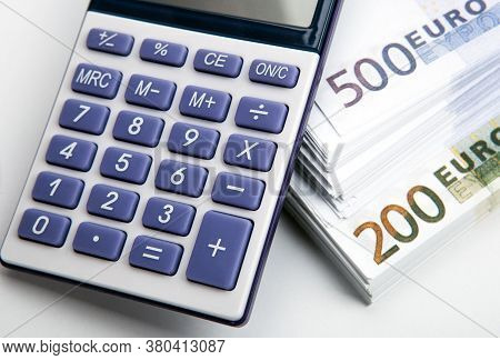 Calculator And A Bundle Of Banknotes 500 And 200 Euros Top View