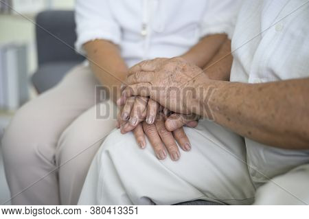 Close Up Of Elderly Hands Holding Each Other , Grandfather Hands Is Holding Grandma Hands , Together