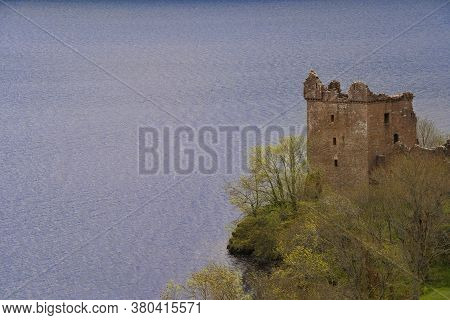 Urquhart Castle In Scotland, Resting On The Loch Ness River