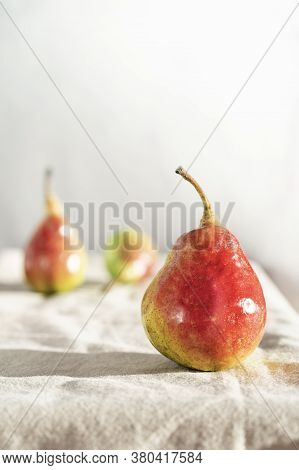 Still Life With Sweet Ripe Organik Pear On A Linen Tablecloth. Pears Harvest. Fruit Background. Autu