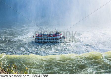 Niagara falls, Canada-Oct 28, 2019: Boat tour coming very close to Niagara Falls. Canada.  America.