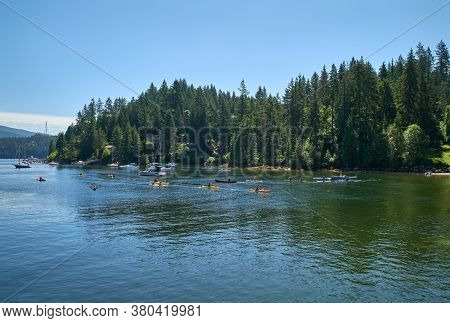 Water Sports at Deep Cove BC. Kayaks and canoes on the water in Deep Cove, British Columbia.