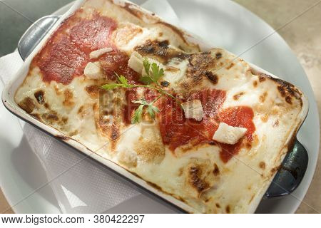 Baked Pencake With Cheese Sauce Or Lasagne Italian Food In Restaurant.