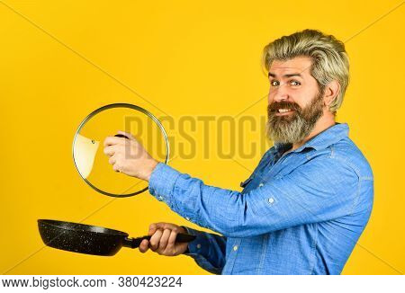 Cooking At Home. Kitchen Utensils. Healthy Food Cooking. Prepare Tasty Dish. Bearded Man Hold Frying