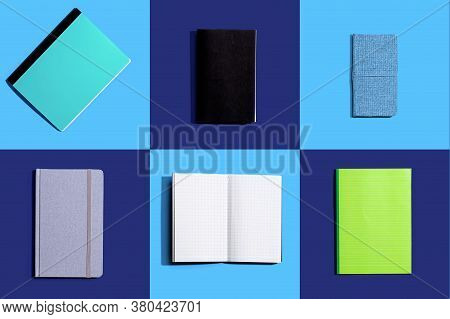 Variety Of Notebooks And Notepads On Tiled Desk Flatlay From Above