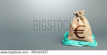 Euro Money Bag And Measuring Tape Meter. Analysis Of The Economic Situation. Assessment Of Capital.