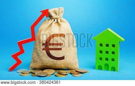 Euro Money Bag With Red Up Arrow And Residential Building. Return On Investment. Increase In Prices