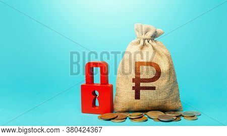 Russian Ruble Money Bag And Red Padlock. Blocking Bank Accounts And Seizing Assets. Cash Flow Monito