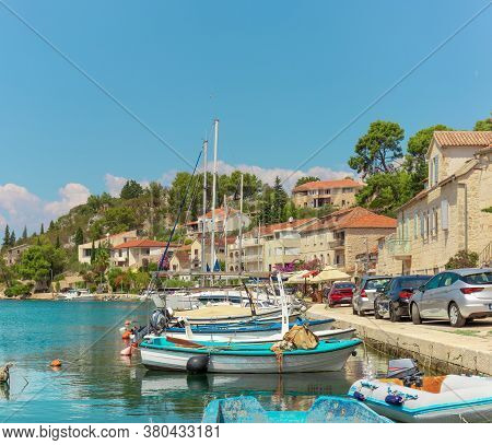Waterfront View Of A Tiny Village Of Bobovisca On The Island Of Brac. Crystal Clear Teal And Green W