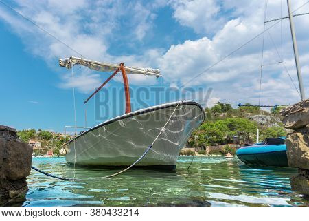 Beautiful Picturesque View Of An Old Ship Docked In The Tiny Port Of Bobovisca On The Island Of Brac