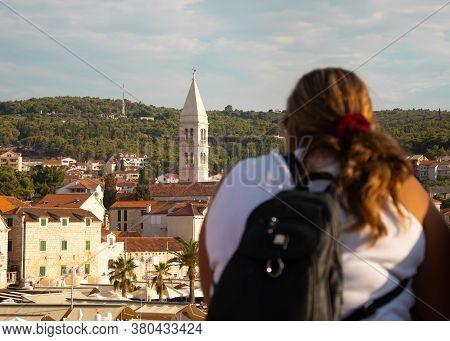 Belltower In The Town Of Supetar On The Island Of Brac Seen In The Distance, Seen From A Ferry With