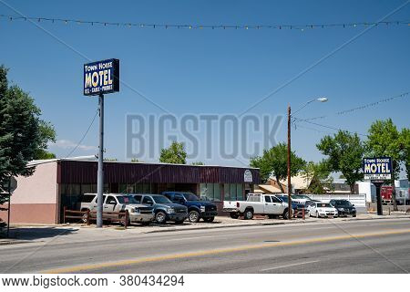 Worland, Wyoming - July 25, 2020: Sign For The Town House Motel, Offering Outdated Amenities Such As