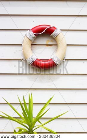 Decorative Life Preserver On Rustic Weather Board Wall