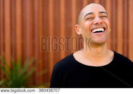 Happy Handsome Multi Ethnic Bald Man In The Streets Outdoors