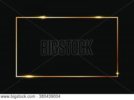 Golden Shiny Glowing Frame Isolated Over Black Background. Gold Metal Luxury Blank Rectangle Border.