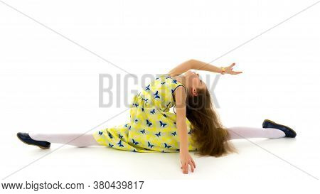 Beautiful Girl Sitting On Twine On Floor, Adorable Long Haired Girl Wearing Yellow Summer Dress And