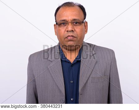 Portrait Of Mature Overweight Indian Businessman In Suit