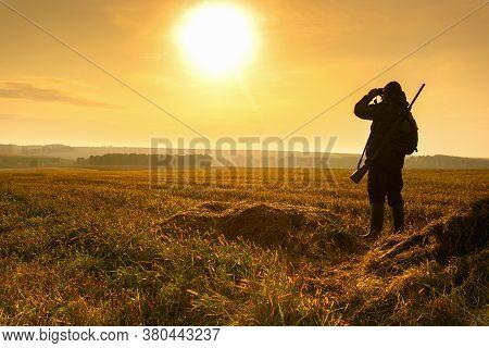 Bird Hunting - Silhouette Hunter At Sunrise.