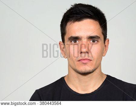 Portrait Of Handsome Man Against White Background