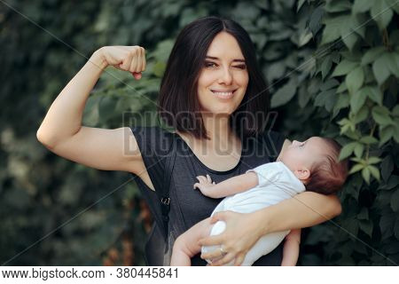 Super Mom In Strong Powerful Pose Holding Newborn
