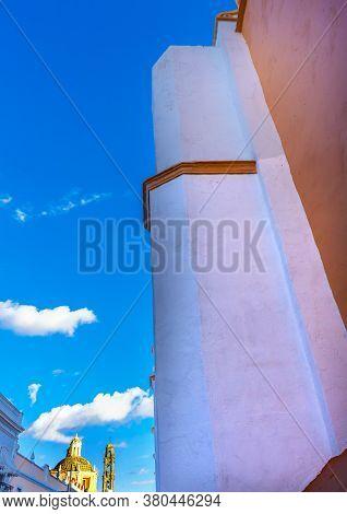 Orange Facade Santa Clara De Asis Church Historic Puebla Mexico.  Sam Cristobal Church In Background