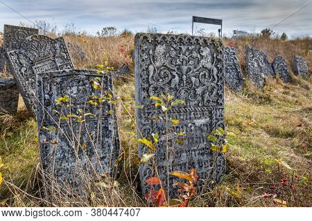 12.10.2019 Satanov Ukraine. Old Jewish Cemetery In The Fall. Tombstones On A Background Of Dry Grass