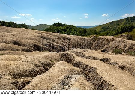 Geological Landscape. Erosion Of The Soil, Weathering, The Formation Of Ravines And Cracks In The Ea