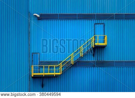 Blue Ladder With Yellow Railing, Colored Background, Structure Of Stairway In Industrial Factory
