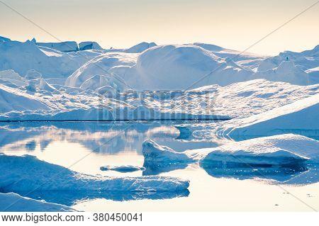 Big Blue Icebergs In Ilulissat Icefjord, Western Greenland.
