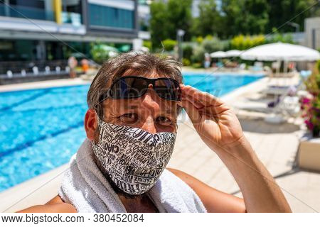 Wearing mask on summer beach vacation