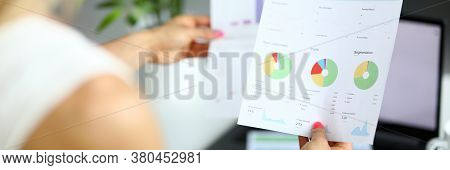 Close-up Of Businesspeople Discuss Working Moment. Woman Holding Papers With Report. Diagrams On Doc