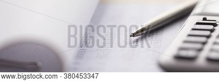 Close-up Of Accounting Tools Lying On Statement. Employee Using Special Equipments. Accountant Balan