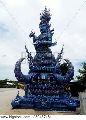 Chiang Rai. Thailand, June 16, 2017: Wat Rong Suea Ten. Blue Sculpture At The Entrance Of The Blue T