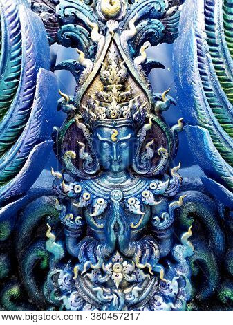 Chiang Rai. Thailand, June 16, 2017: Wat Rong Suea Ten. Detail Of One Of The Blue Sculptures On The
