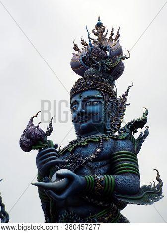 Chiang Rai. Thailand, June 16, 2017: Wat Rong Suea Ten. Closeup Of Blue Sculpture At The Entrance Of