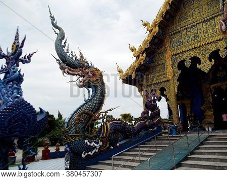 Chiang Rai. Thailand, June 16, 2017: Wat Rong Suea Ten. One Of The Surreal Dragons On The Stairs Of