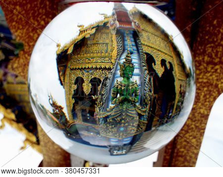 Chiang Rai. Thailand, June 16, 2017: Wat Rong Suea Ten. Reflection In A Crystal Ball Of One Of The S