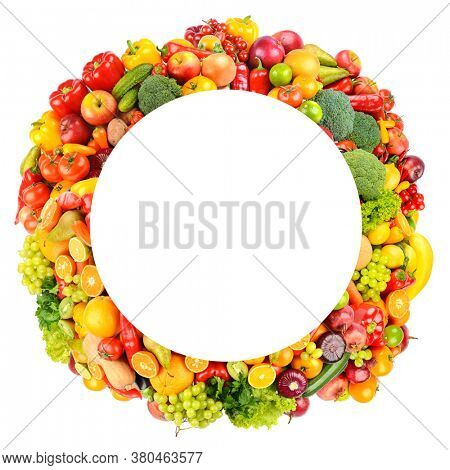 Round frame of bright and colorful fruits, vegetables and berries isolated on white background.