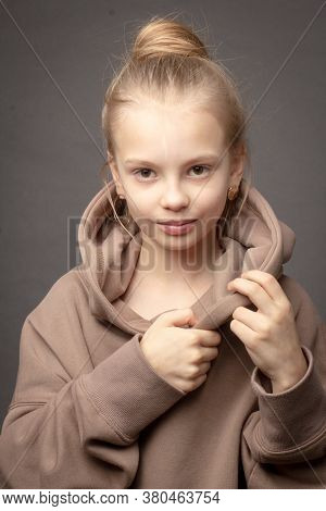 Hild-girl With Long Hair Gathered In A Bun