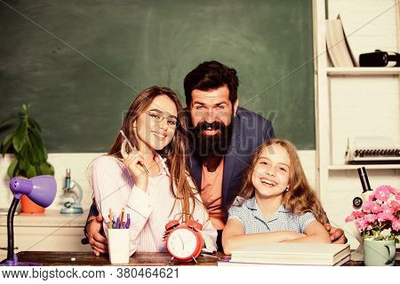 Happy Lesson. Happy Family Have School Lesson. Little Child And Parents During Lesson Time. Private