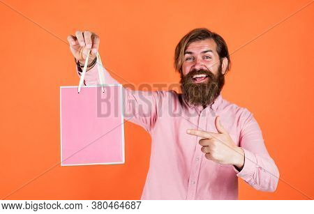 Outgoing Man Choosing Product. Happy Bearded Man With Present Pack. Brutal Hipster Hold Gift. Paper